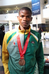 habang Masihleho proudly displays his bronze medal.